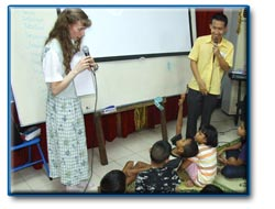 Teacher Lisa teaching children about their Heavenly Father who loves them!